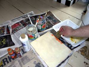 Sponging on paint around the edges.
